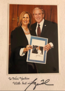 With US President Goerge Bush in the Knesset during his visit to Israel at the 60th state anniversary - holding a picture of them when visiting the Knesset as Governor of Texas